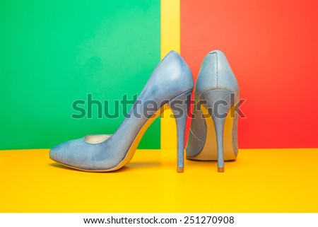 blue high heels shoes on colored background - stock photo