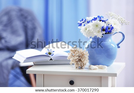 Blue home decor on bedside table in the room - stock photo