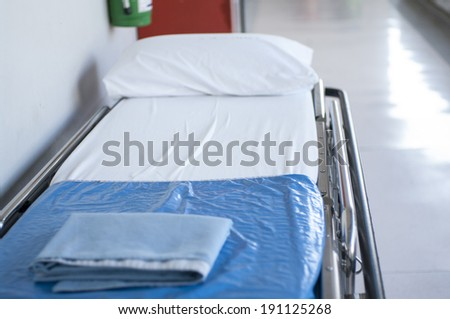 blue hospital wheeled bed with pillow - stock photo