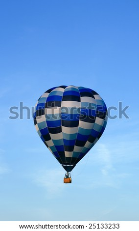 Blue hot air balloon in the evening sky.