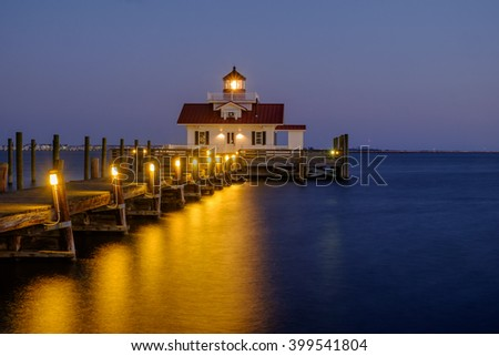 Blue hour at sunset over the Roanoke Marsh Lighthouse in Manteo North Carolina - stock photo