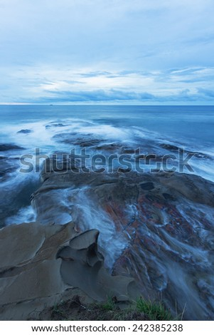 Blue hour with long exposure on the rock at Tip of Borneo,Kudat,Sabah - stock photo