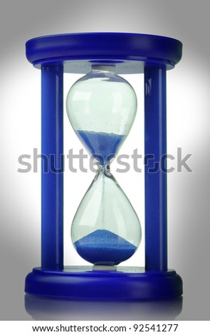 Blue hourglass isolated on white - stock photo