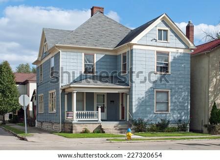 Blue House on Corner - stock photo