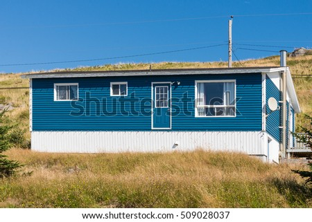 Blue house with back door without steps (mother in law door)