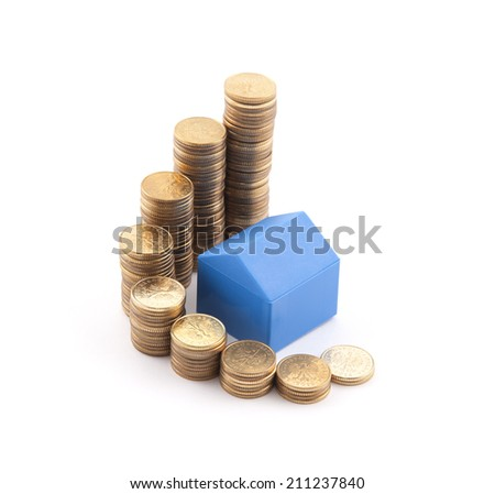 Blue house with stack of coins - stock photo