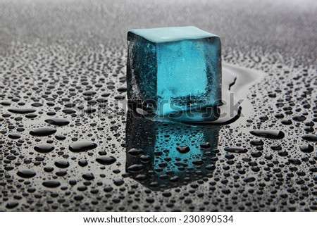 Blue ice cube - stock photo