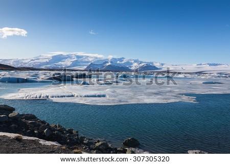 Blue ice floating lake in Jokulsarlon lagoon during winter, Iceland - stock photo