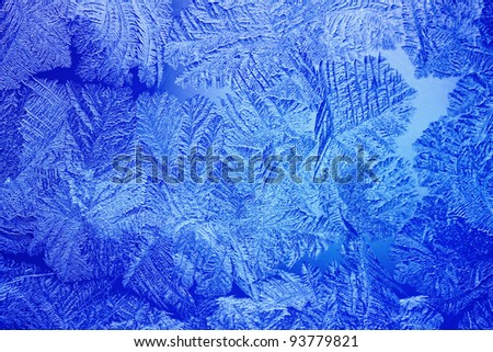 Blue Ice patterns made by the frost on the window - stock photo