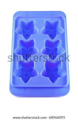 Blue ice tray star shape isolated on white background - stock photo