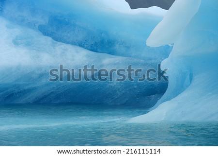 blue iceberg floats in southeast alaska - stock photo