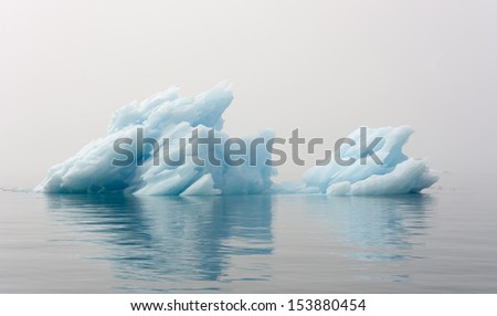 Blue icebergs of Greenland. The most ancient continental ice. Fantastic foggy landscapes.