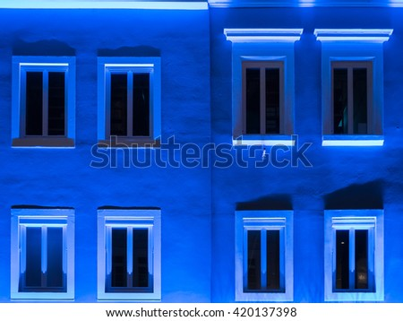 Blue illuminated house front