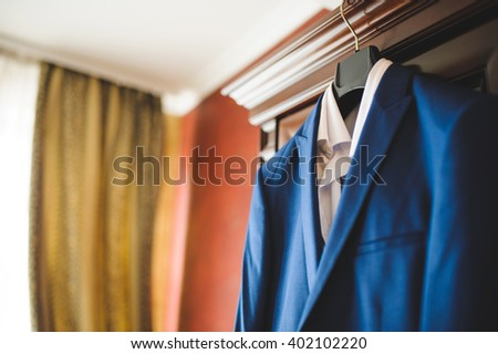 blue jacket and white shirt on wardrobe