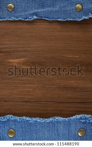 blue jean on wood texture background - stock photo