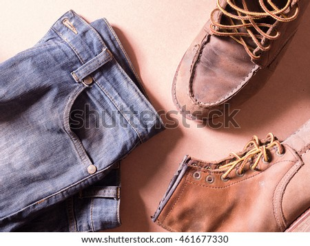 blue jean with still life of old leather boots, work harder men style