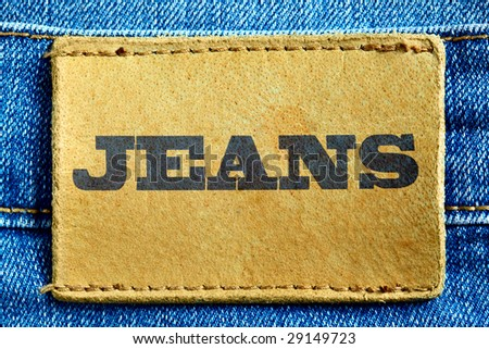 "Blue jeans and leather label with word ""Jeans"""