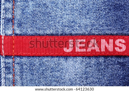 "Blue jeans and red label with word ""Jeans"""