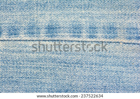 Blue jeans background with seam and scrapes