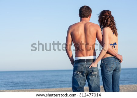 Blue jeans blue sky blue water - stock photo