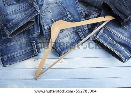 blue jeans fashionable clothes shirt pants Blue rusty vintage wood background
