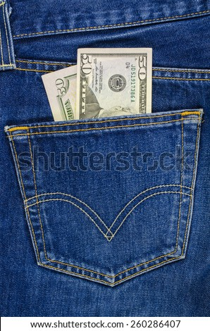 Blue jeans pocket with dollars