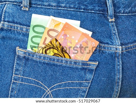 Blue jeans pocket with euro notes and credit card