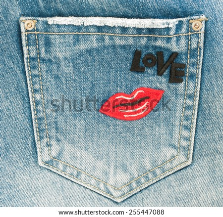 Blue jeans pocket with lip and love word - stock photo
