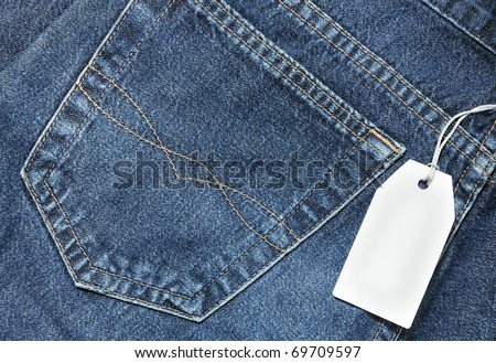 Blue jeans pocket with price tag - stock photo
