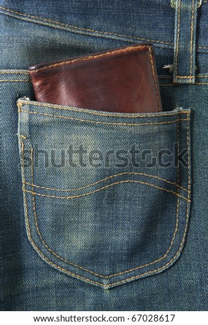 blue jeans pocket with Wallet brown - stock photo