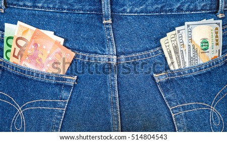 Blue jeans pockets with euro and american banknotes. Money for travel and shopping