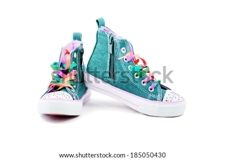 Blue jeans sneakers with rainbow laces isolated on white - stock photo
