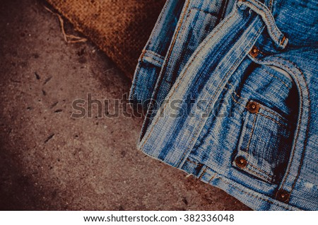 Blue jeans texture background, Old Jean fashion design.Blue jeans on a brown  background.textures ripped jeans.background of a stack  jeans.hipster fashion jeans.jeans texture.Texture of blue jeans  - stock photo