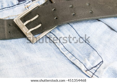 Blue jeans with a black leather belt