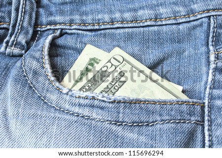 Blue jeans with american 20 dollar bill on its pocket - stock photo