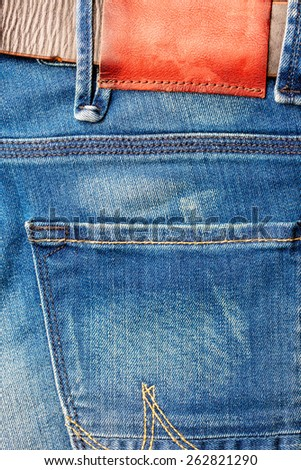 Blue jeans with blank leather label - stock photo