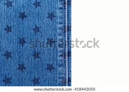 blue jeans with star stamp and white thread seams on white background, close up, top view,  fashion background - stock photo