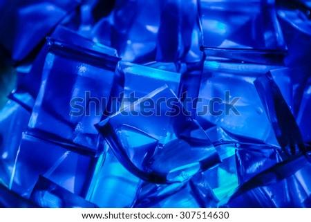 Blue Jell-O gelatin cubes lit from below. - stock photo