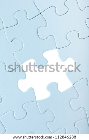 Blue Jigsaw puzzle with white piece missed close up