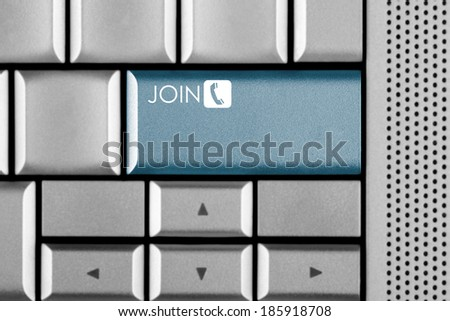 Blue JOIN key on a computer keyboard with clipping path around the JOIN key - stock photo