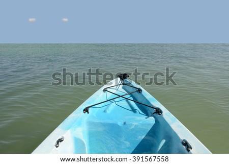blue kayak in the ocean - stock photo