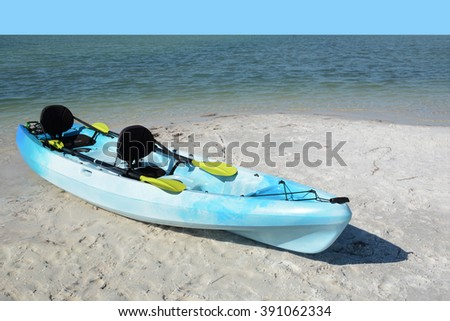 blue kayak on the beach tropical setting - stock photo