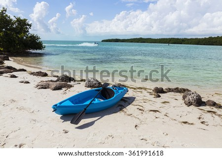 Blue kayak on the Coco Plum Beach, , turquoise colored sea. Florida - stock photo