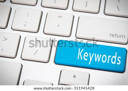 Blue keywords button on the keyboard - stock photo