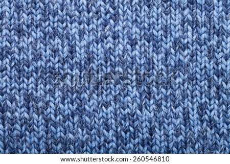 Blue knitted fabric made of heathered yarn textured background - stock photo