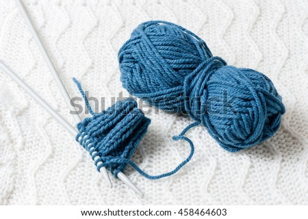 Blue knitting wool and knitting needles, knitting equipment