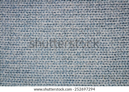 Blue knitting wool texture closeup photo background.
