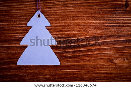 Blue label on the wooden background - stock photo
