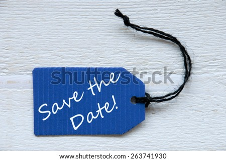 Blue Label Or Tag With Black Ribbon On White Wooden Background With English Text Save The Date Vintage Retro Or Rustic Style - stock photo