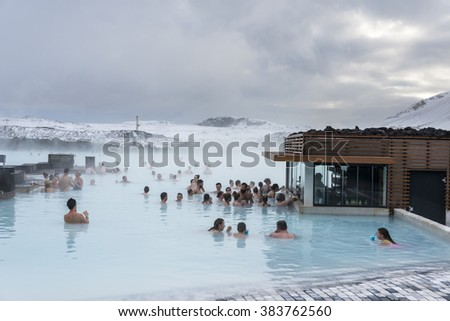 Blue lagoon, Iceland - February 20, 2016: People in SPA are drinking cocktails near  a cafe on the water, Blue lagoon in winter. - stock photo